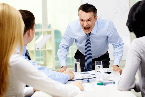 An angry manager shouting at workers in an office