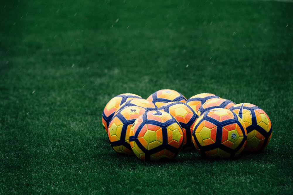 Footballs on a pitch