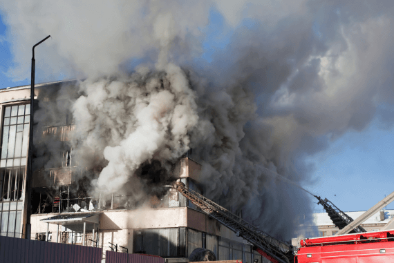 A burning building releasing smoke and harmful fumes