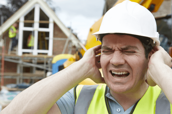 A construction site worker suffering from excessive noise