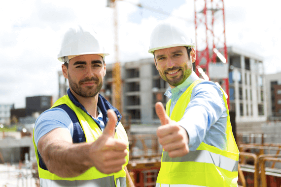 Two male construction workers thumbs up