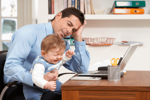 A man trying to work from home being distracted by a young child