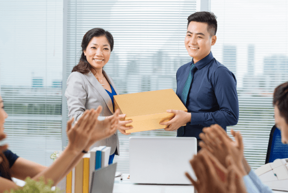 Employee receiving a bonus gift for good work