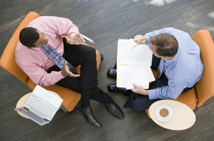 Two executives engaged in business coaching
