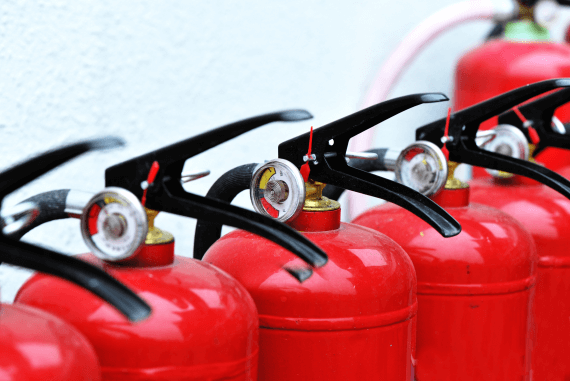 Red fire extinguishers in a line