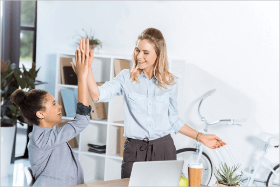 Happy motivated employees high five