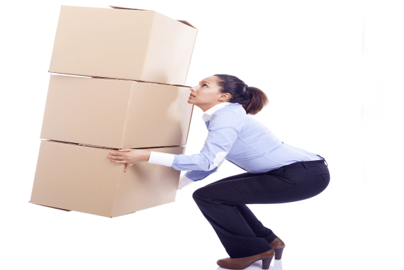 A female office worker lifting a lot of cardboard boxes