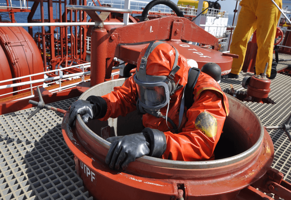 Worker in a confined space on an offshore oil and gas rig
