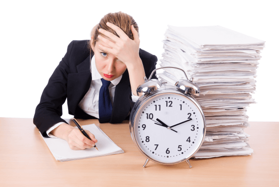 A manager with lots of paperwork and a clock