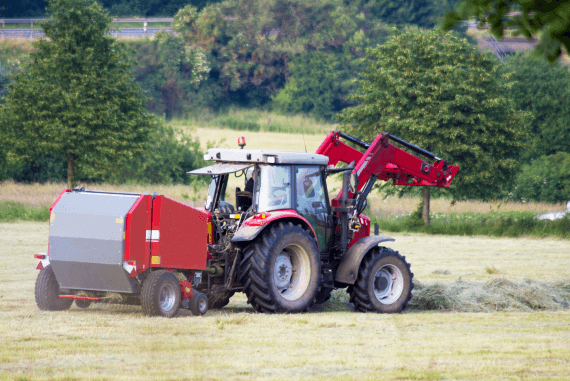 An agricultural tractor in a field