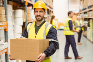 A warehouse worker holding a cardboard box