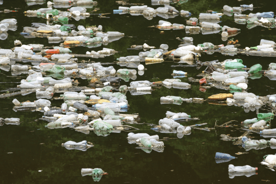 Polluted water filled with discarded plastic